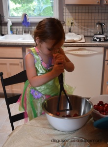 M helping to mash the berries